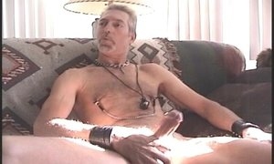 Horny mature bear masturbating on the couch